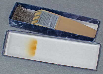 Staticmaster 1 inch brush with radiation burn to the lid, in Company Seven's collection (98,265 bytes)